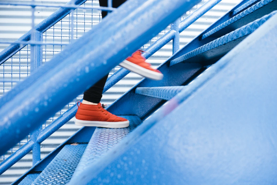 A person exercises and climbs the stairs.