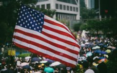 Tens of thousands of protesters waving US flags marched on Hong Kong's US Consulate to call for help from Trump.  Featured Photo by Joseph Chan.