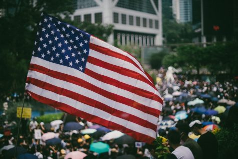 Tens of thousands of protesters waving US flags marched on Hong Kong