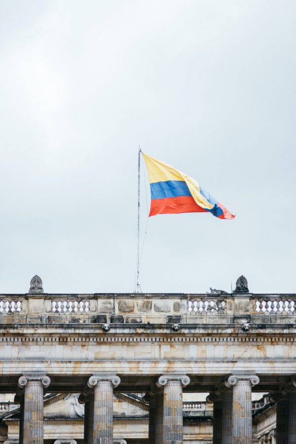 The Colombian flag waves in the wind. In Colombia, police brutality is often ignored or misrepresented by the media.