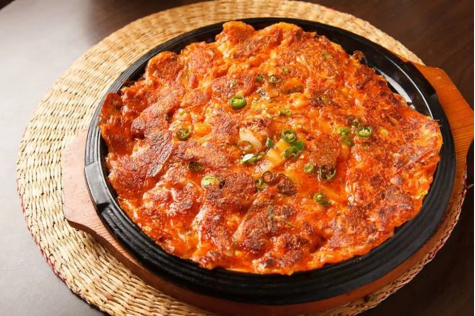The kimchi pancake, also referred to as kimchi-jeon, is a traditional Korean folk dish and can be served as a snack, side dish, or appetizer.